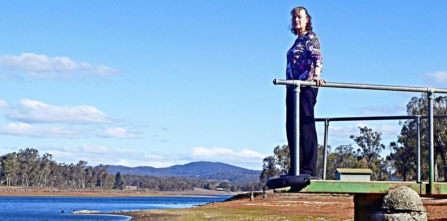 LEVY A WASH: Cr Marika McNichol takes in the sad sight of Storm King Dam ahead of a proposed water levy to supply Stanthorpe.