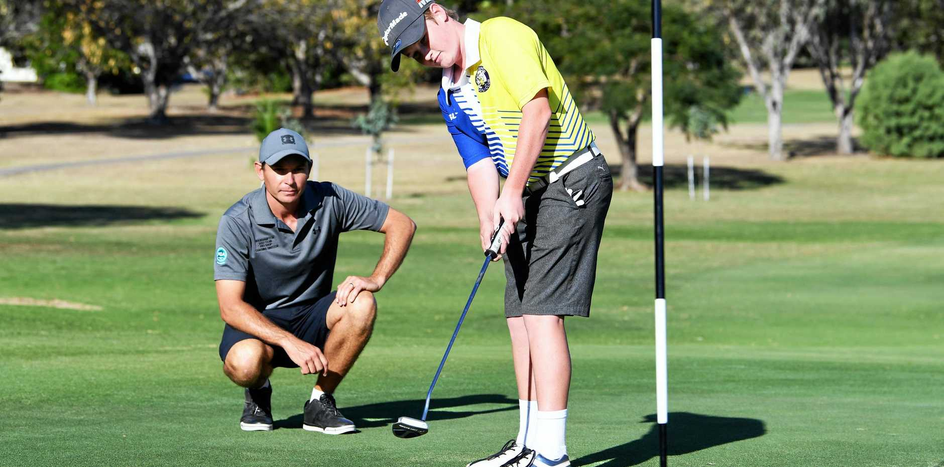 THE PRO TOUCH: Professional coach Jeffery Hoy and Lincoln Beckett at the Rockhampton Golf Club junior clinic earlier this week.