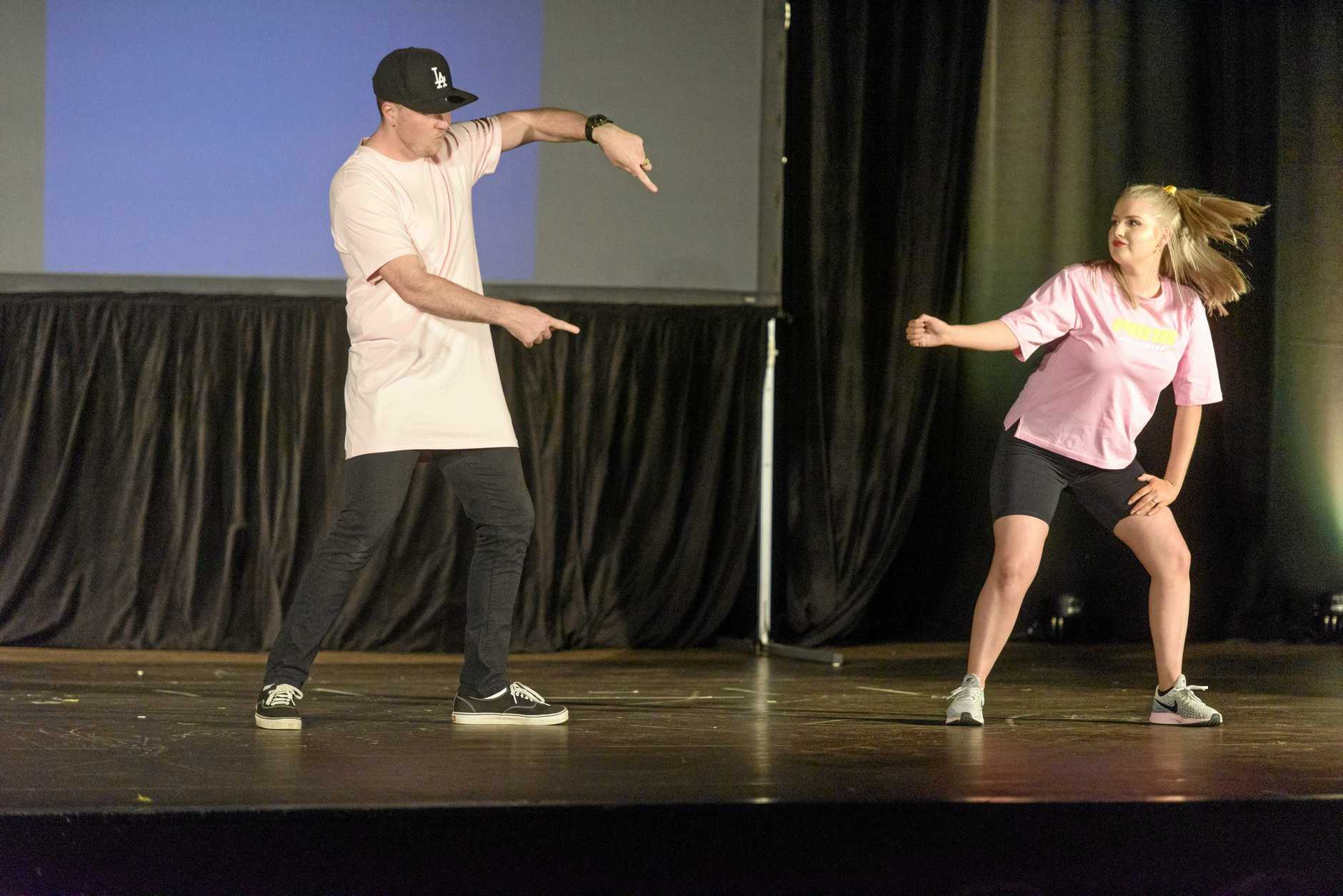 Teacher Jeremy Jablonski with Phillipa Covington get into hip hop in their dance for Stars of Clarence.