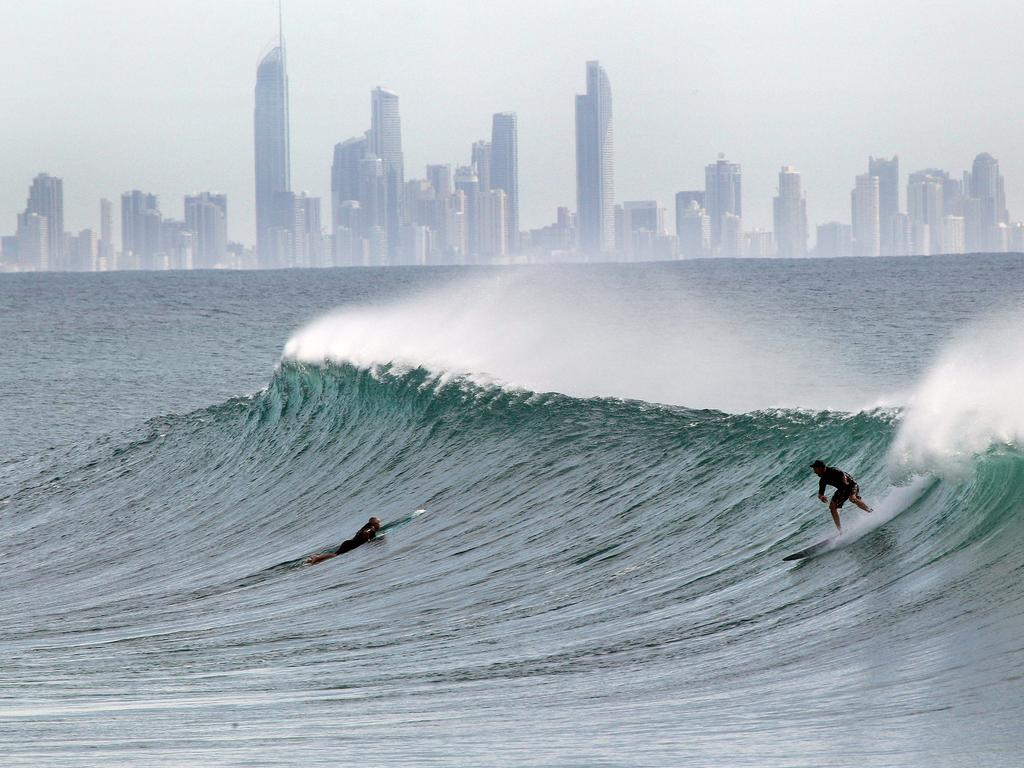 Surfers hit the water at Snapper Rocks. Picture: Mike Batterham