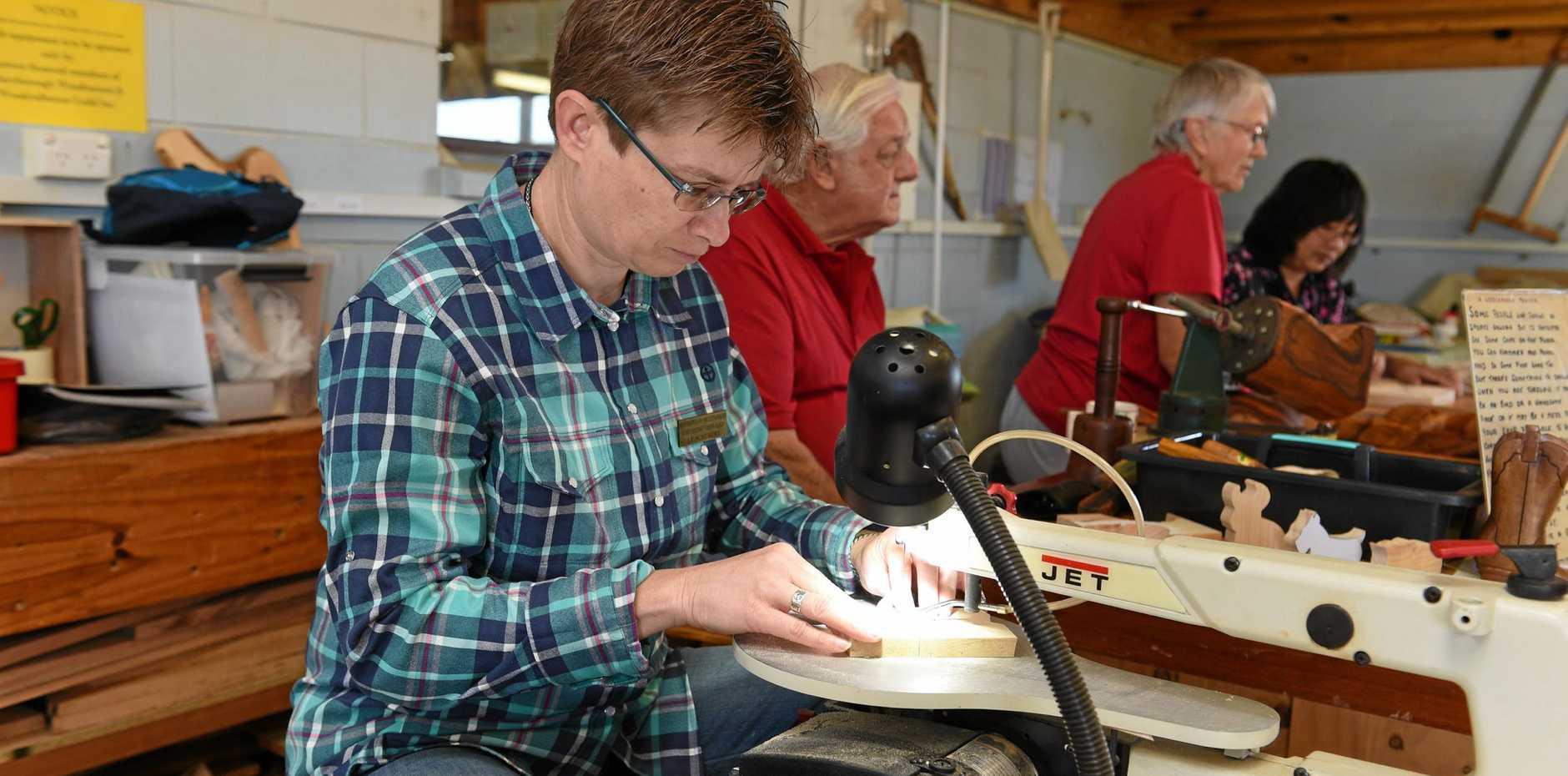 CUTTING THROUGH: Lu Schubert working on the scroll saw.