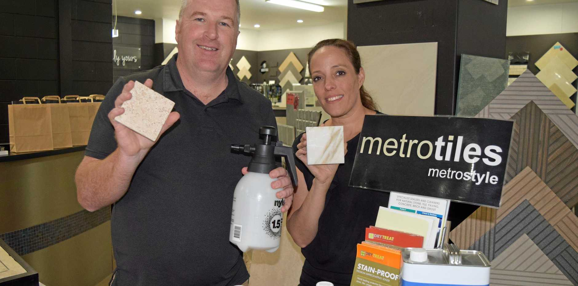 LEARNING SKILLS: Dry Treat territory sales manager Nathan Walsh and Metro Tiles sales consultant Sheila Car with some of the products used at the tradies night.