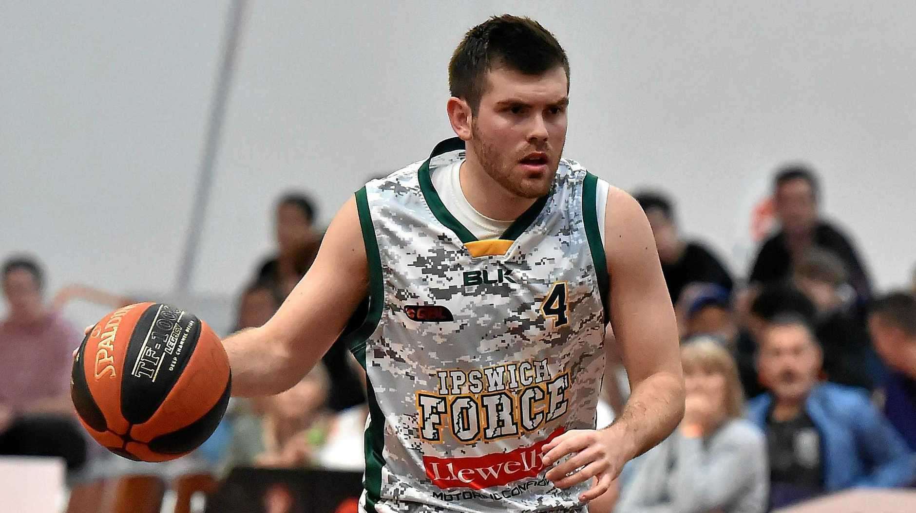 Ipswich Force captain Jason Ralph sets up an offensive play during the recent QBL match against Sunshine Coast Phoenix. His immediate playing future is in limbo after a back injury flared.