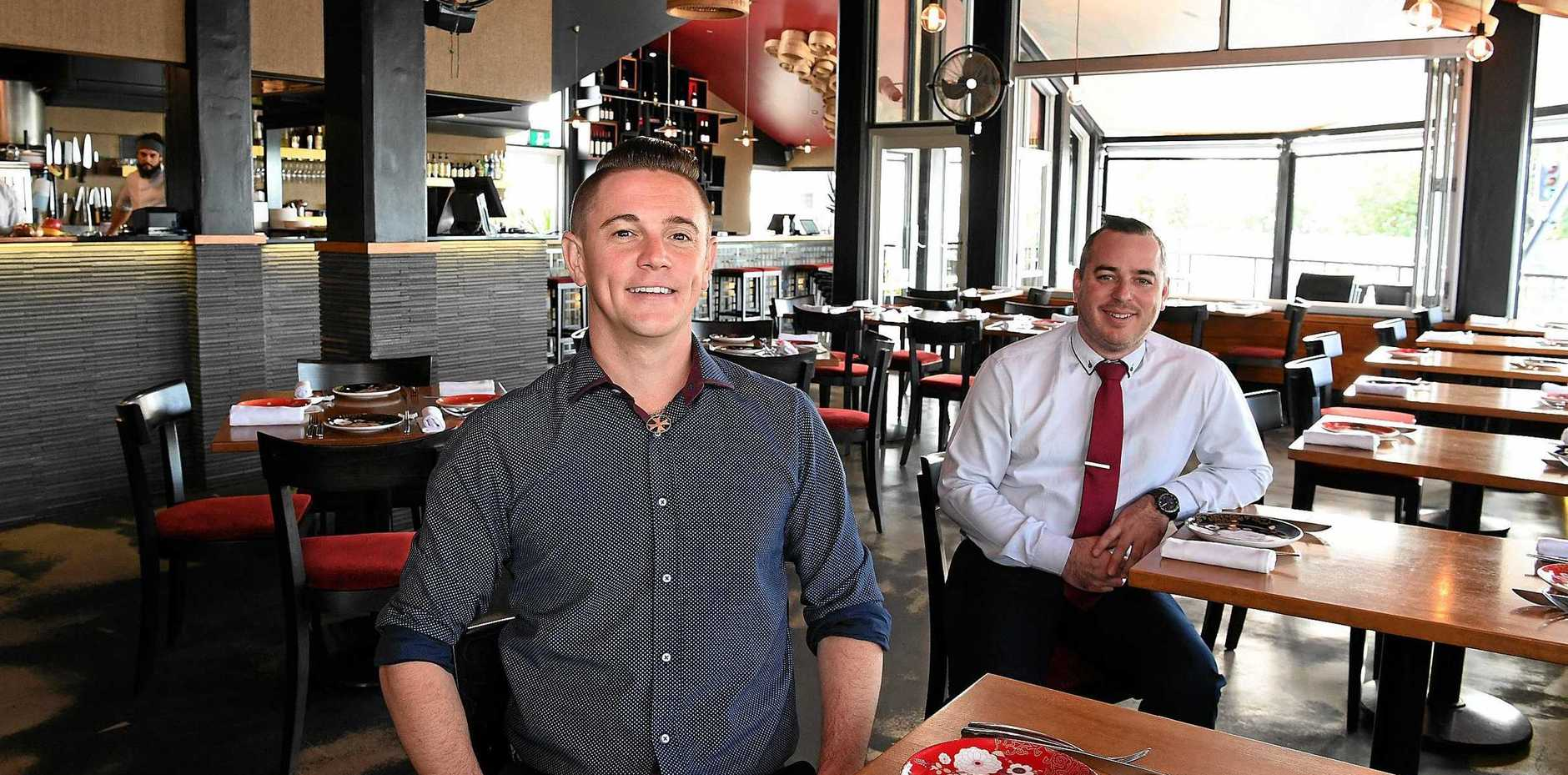 EXCITING: New owners taking charge of the Spice Bar at Mooloolaba. General manager Ross Charnock and co-owner Ian Dunham looking forward to serving customers.