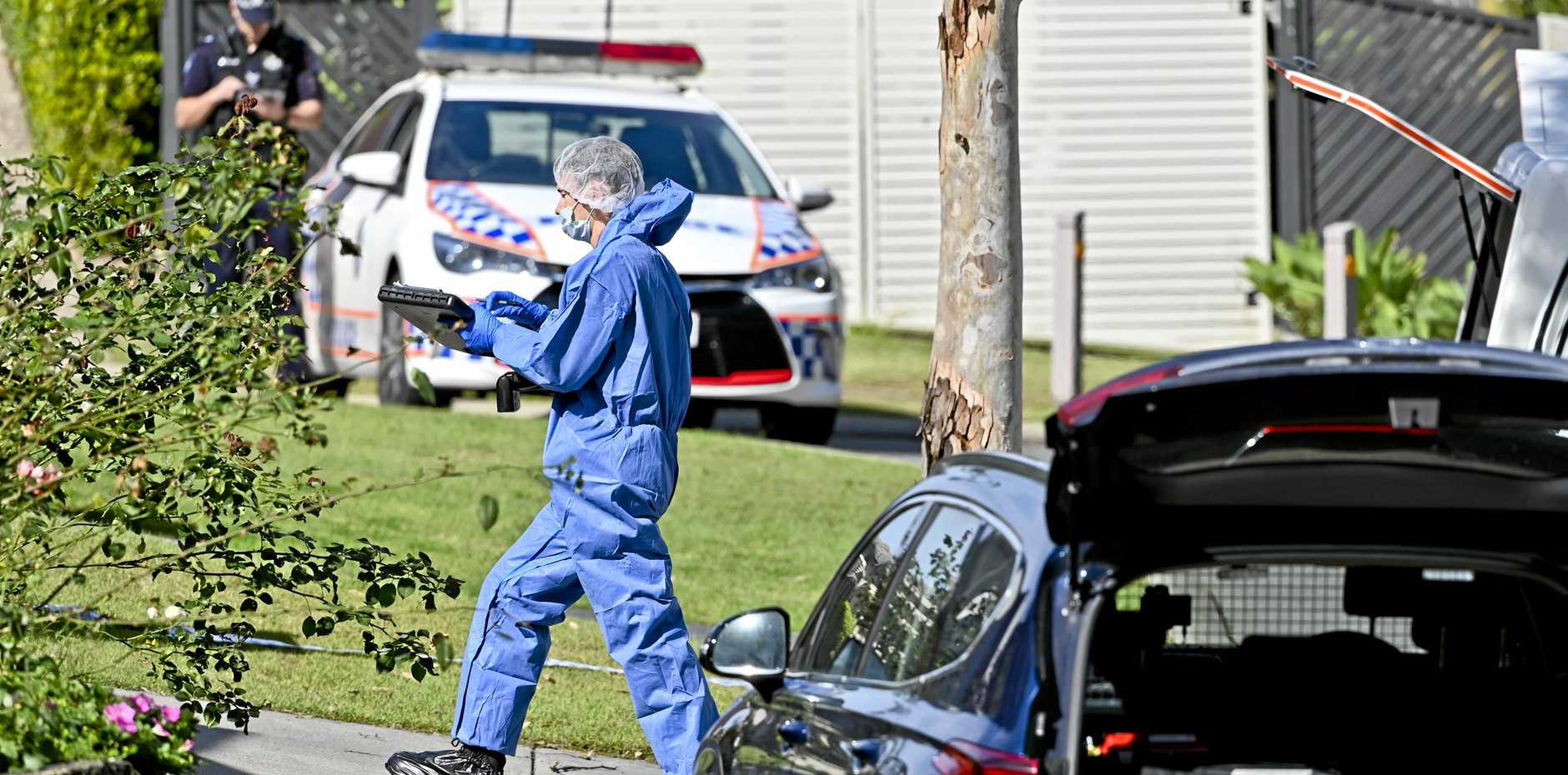 INVESTIGATION: Police at the alleged crime scene at Mountain Bell Ln, Springfield Lakes.