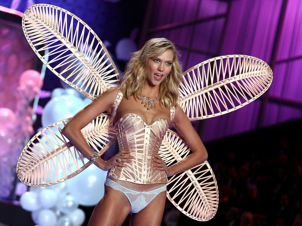 Karlie Kloss at the Victoria's Secret fashion show at Earls Court on December 2, 2014 in London. She reveals why she quit the brand in a new interview. Picture: Getty Images