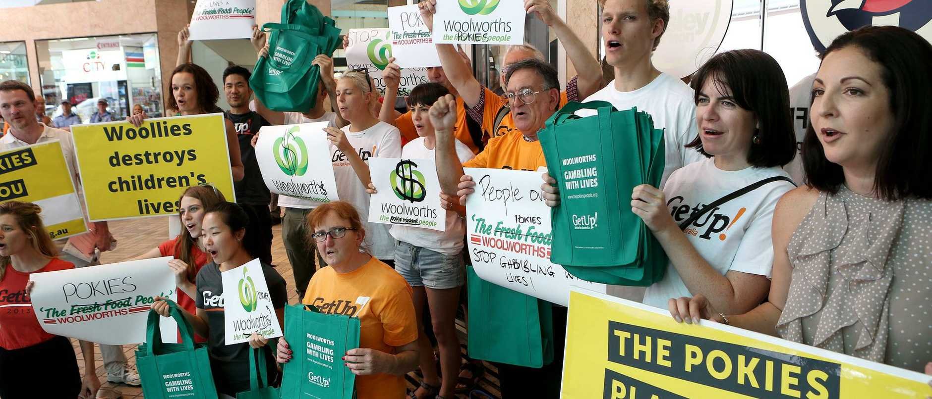 Protesters urging Woolworths to divest from pokies at the Woolworths AGM.