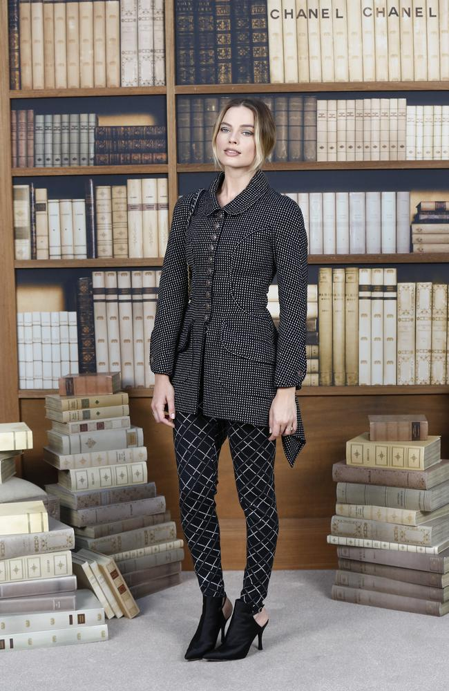 Margot Robbie inside Chanel's library-themed runway show in Paris. Picture: AP Photo/Kamil Zihnioglu
