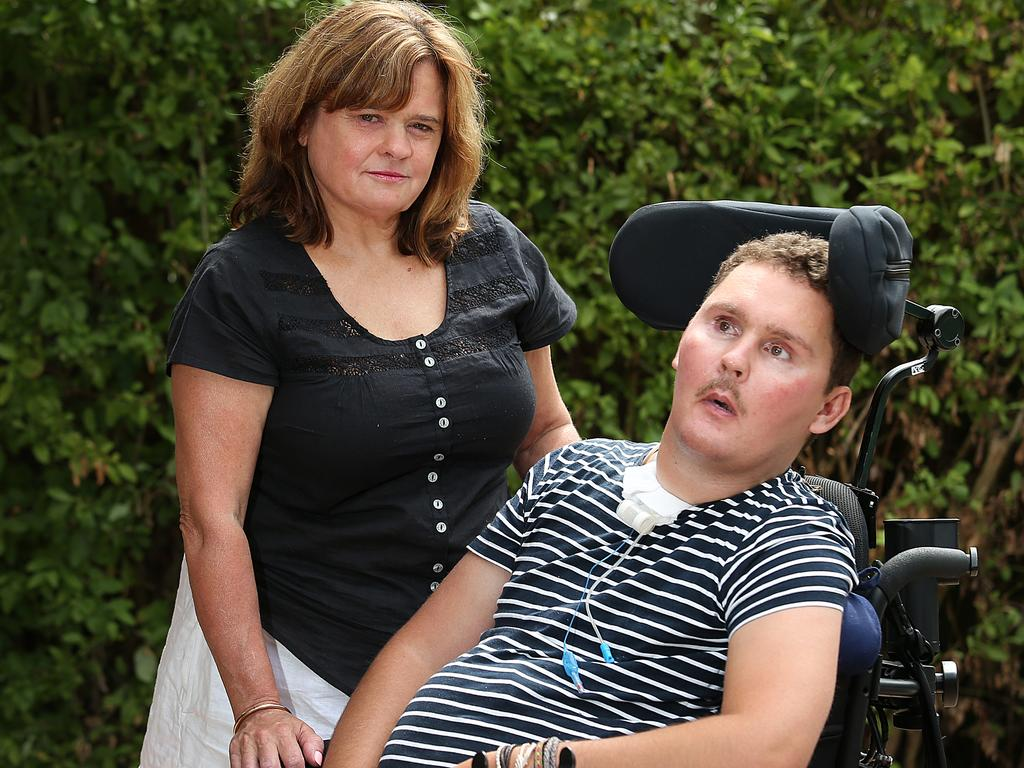 Sam with his mother Katie after rat lungworm from the slug caused meningitis and left him severely disabled.