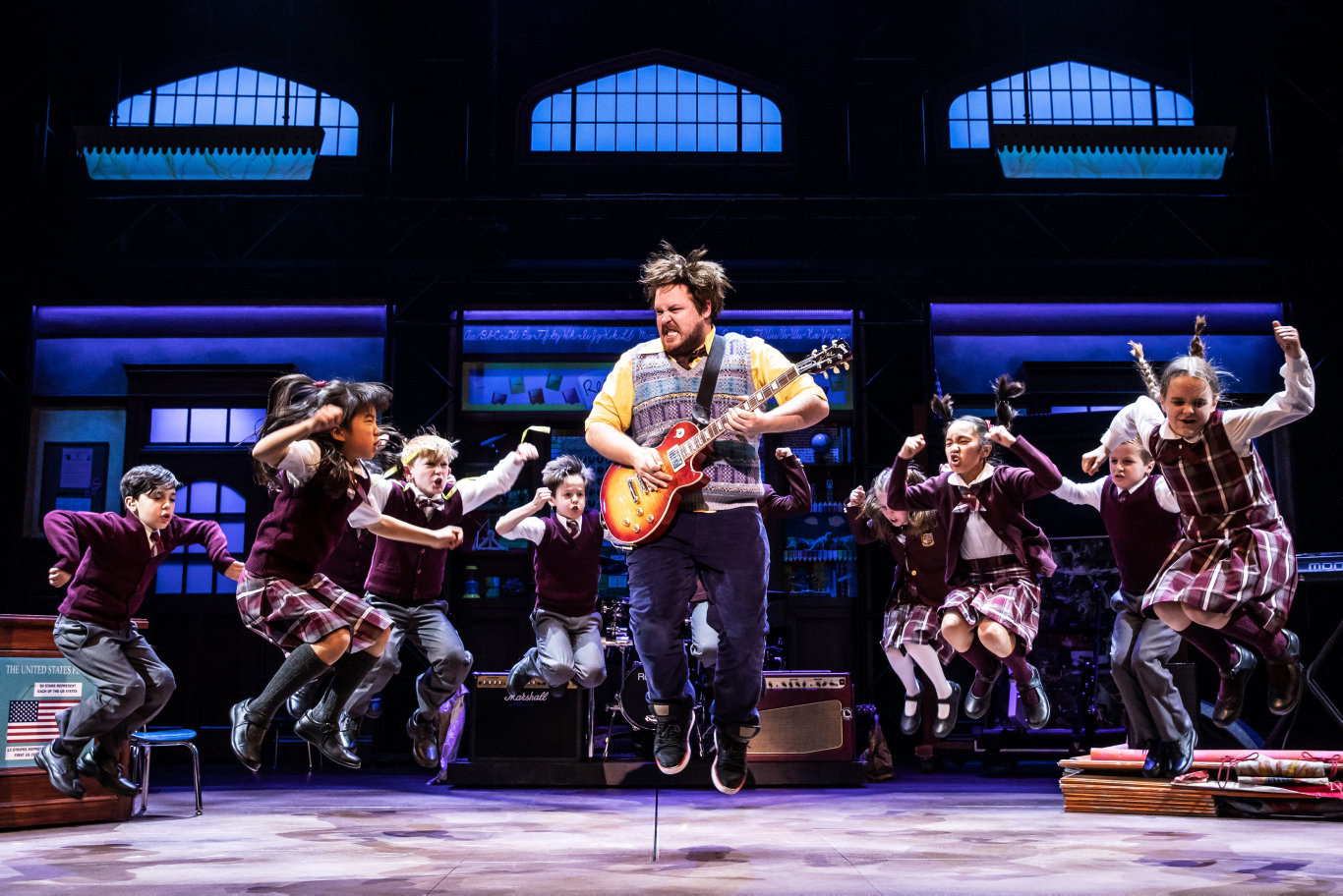 Brent Hill, centre, stars as Dewey in School of Rock The Musical.