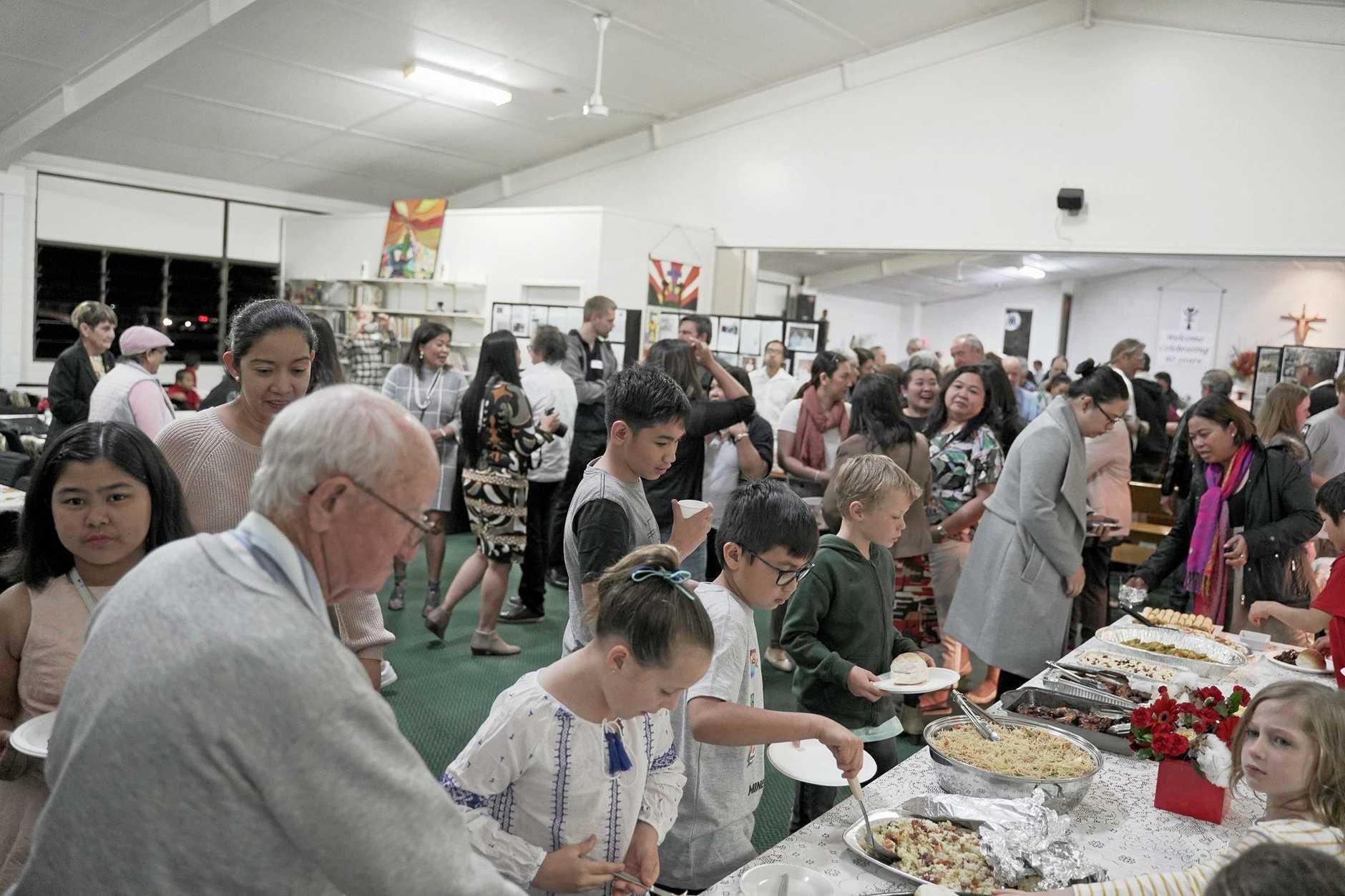 40 UP: Good food and good company at St Joseph's Moranbah's 40th anniversary celebration.