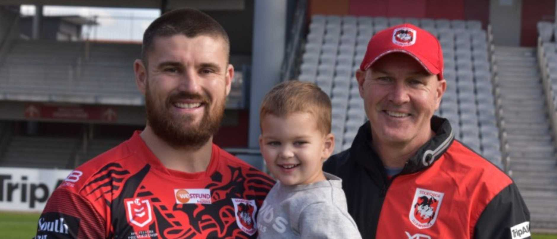 Mitchell Allgood with son Peter and Dragons coach Paul McGregor.