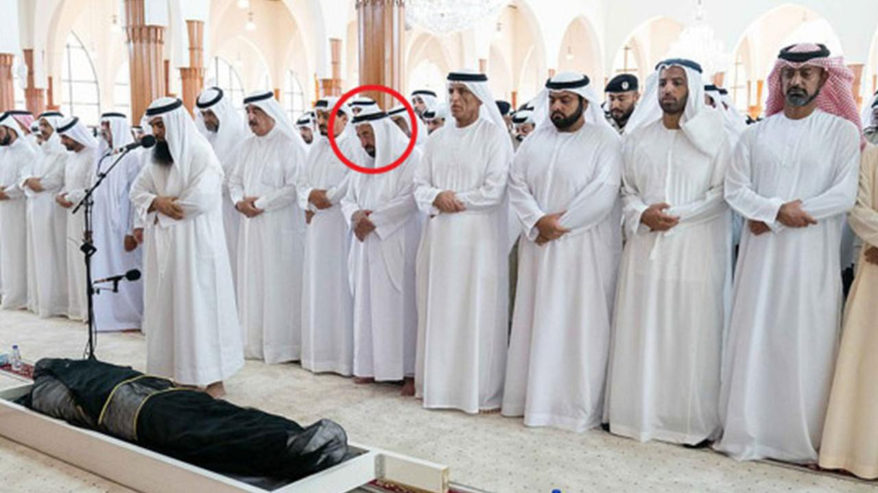 Sheik Dr Sultan bin Muhammad Al Qasimi (circled) stood over the body of his son with his eyes closed. Picture: hhshkdrsultan/Instagram