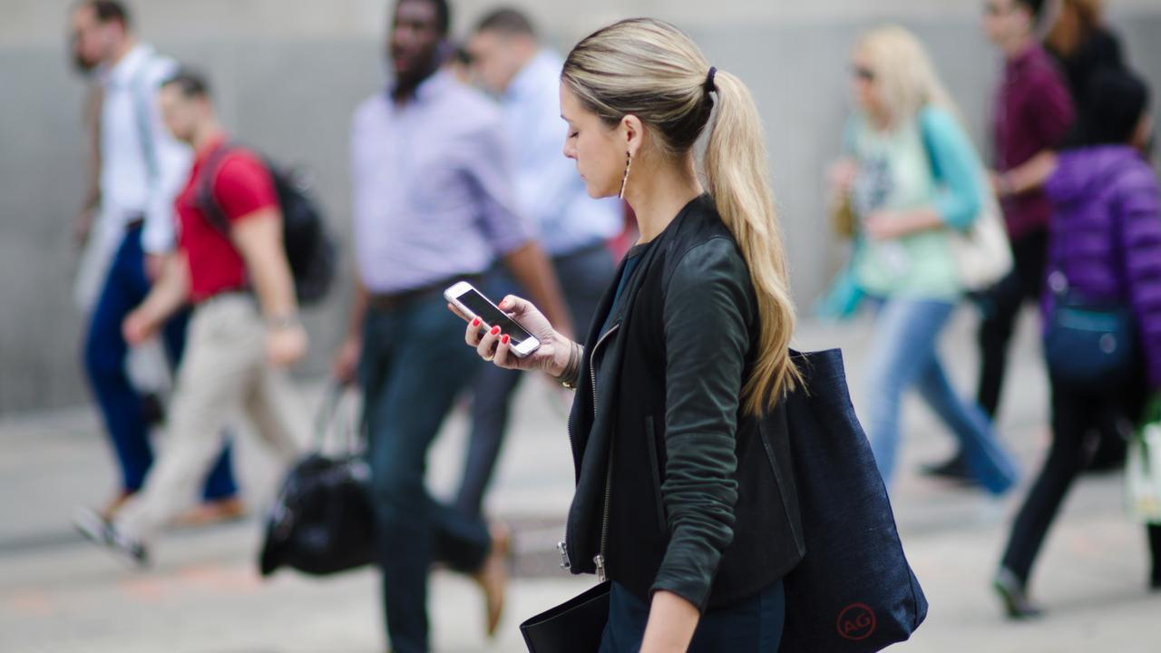 Call for pedestrians to be fined $200 for using their phones. Picture: iStock