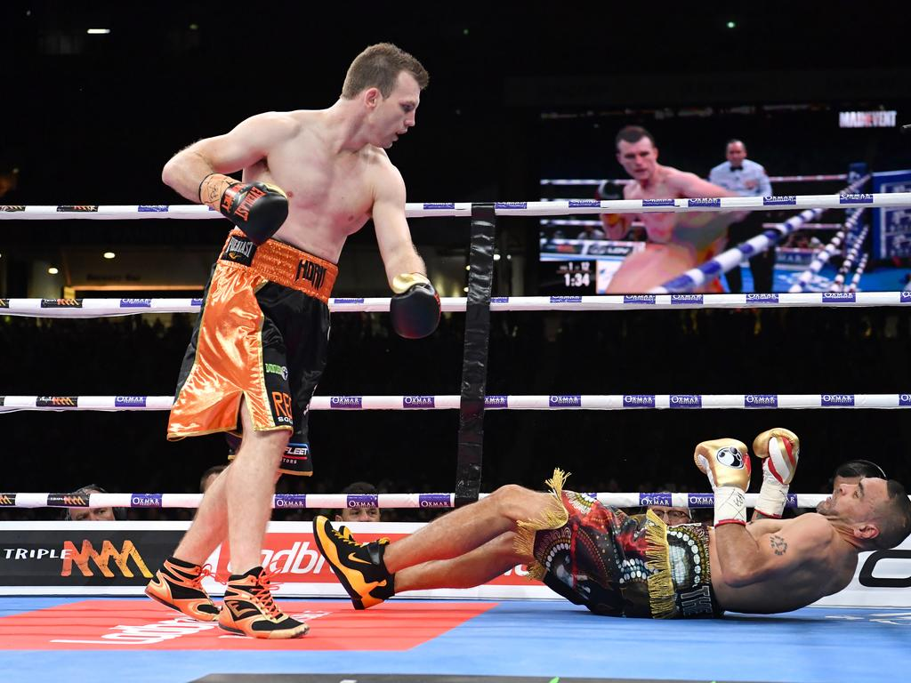 Jeff Horn knocks out Anthony Mundine in the first round. (AAP Image/Darren England)