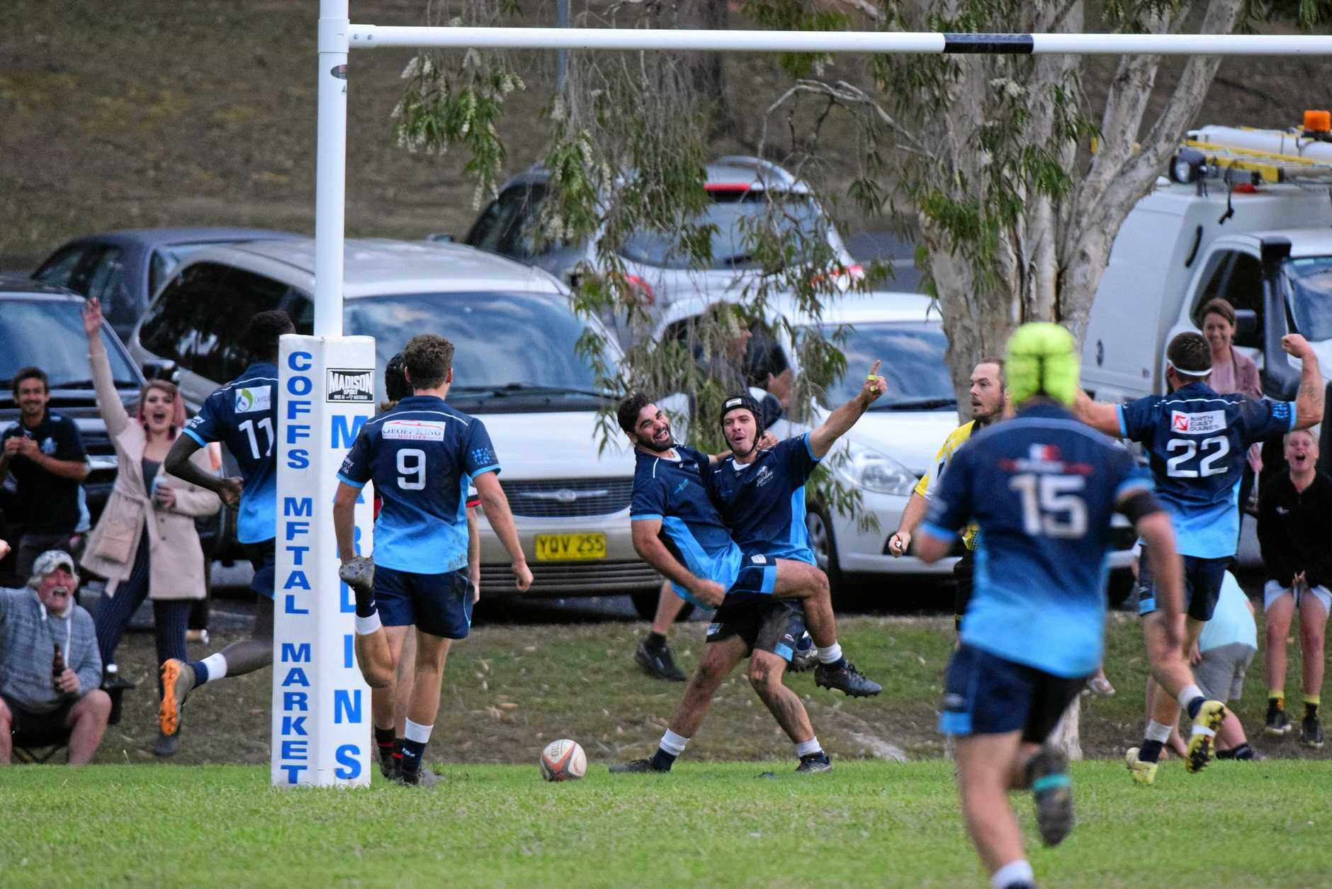 YOU'RE KIDDING: Marlins players celebrate their match winning try which came well after the 80 minutes had passed.