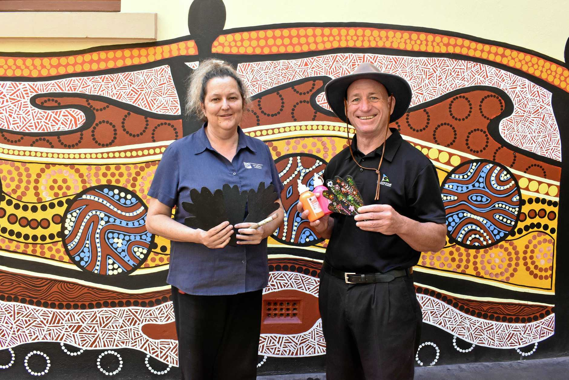 CREATIVE: GRC Councillor Chris Trevor with Gladstone Regional Art Gallery and Museum Manager Jo Duke getting hands on with the gallery's NAIDOC week activities.