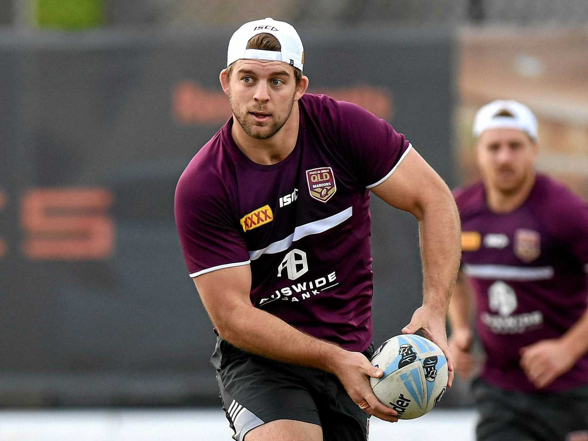 Christian Welch looks to offload during a Queensland  training session in Brisbane on Thursday. Picture:  Bradley Kanaris/Getty Images