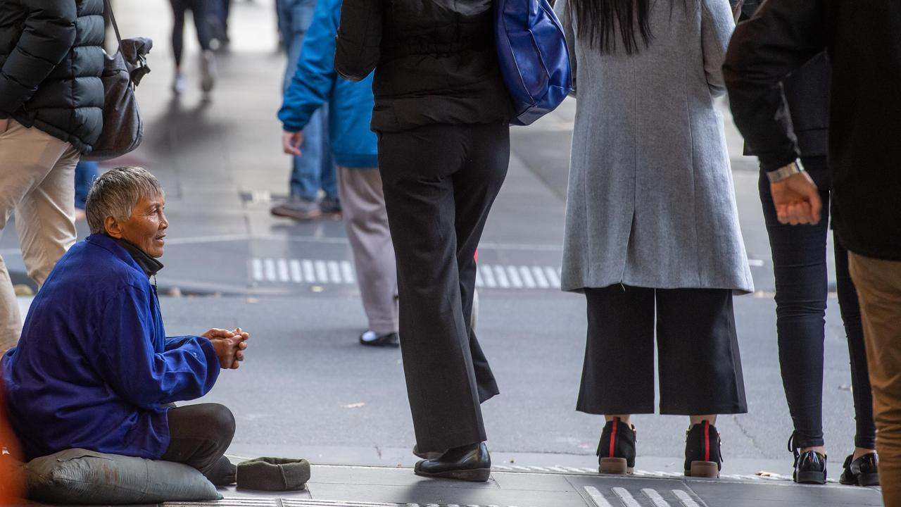 One of the women begging in Melbourne's CBD. Picture: Jason Edwards