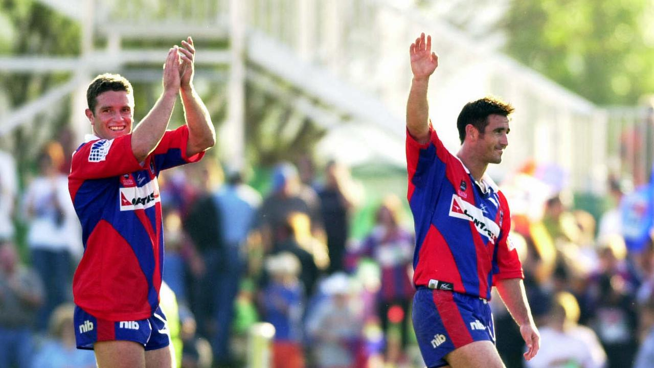 The Knights' Danny Buderus and Andrew Johns acknowledge the crowd's applause after a win over Canberra Raiders in Newcastle.