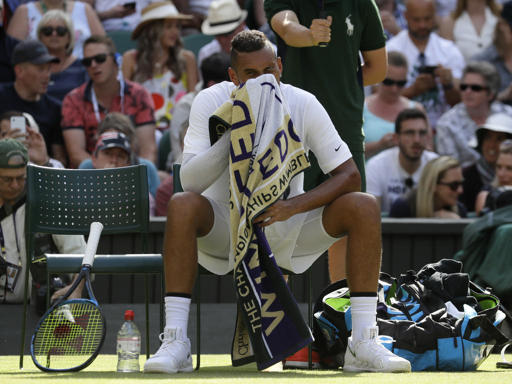Australia's Nick Kyrgios wipes his face during a change of ends. (AP Photo/Kirsty Wigglesworth)