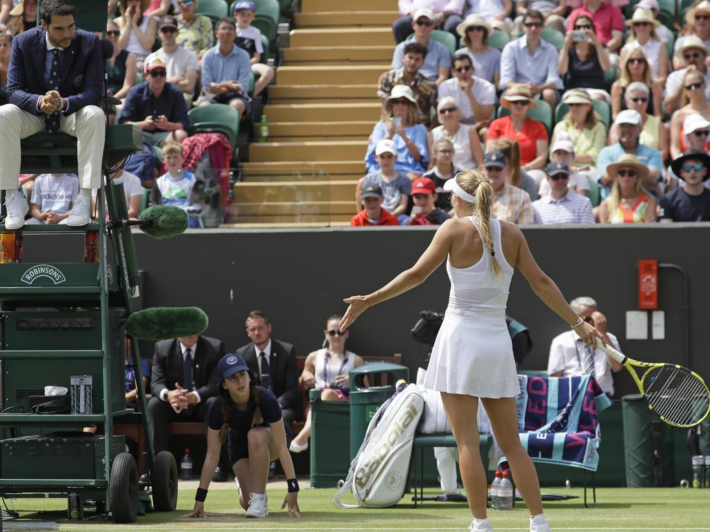 Caroline Wozniacki remonstrates with umpire Nacho Forcadell as she disputes Hawkeye.