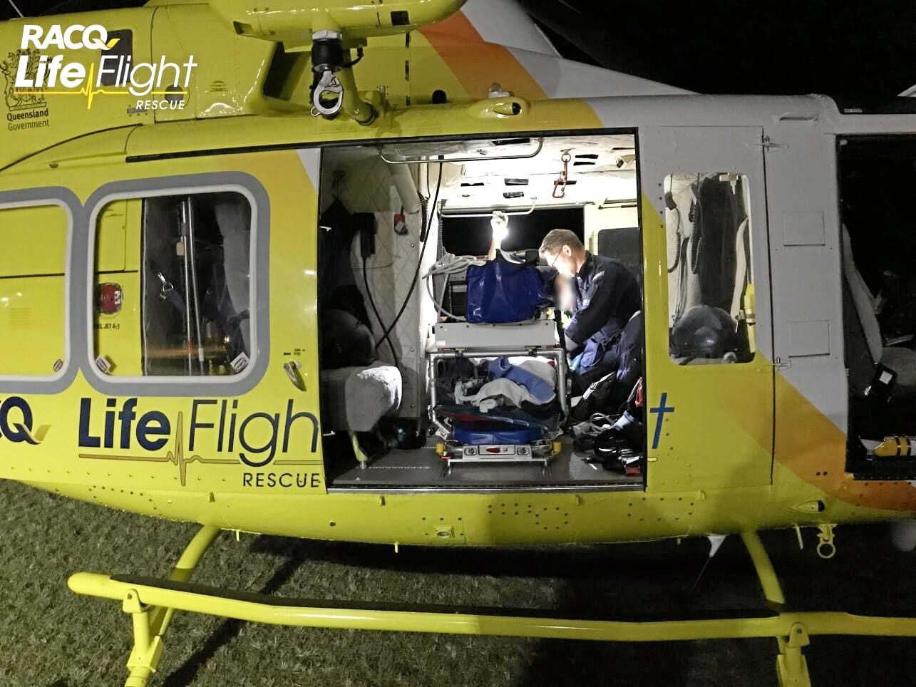 Sunshine Coast RACQ LifeFlight Rescue helicopter airlifts a 40-year-old woman to Sunshine Coast University Hospital after a crash near Childers which killed a 18-year-old Sippy Downs man.
