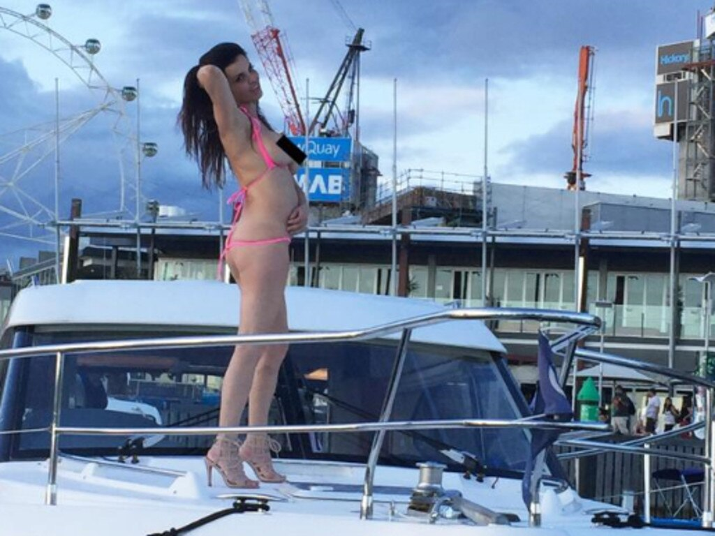 Suzi Taylor dances topless on boat. Picture: Supplied