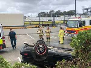 Shocking moment vehicle lands upside down in car park