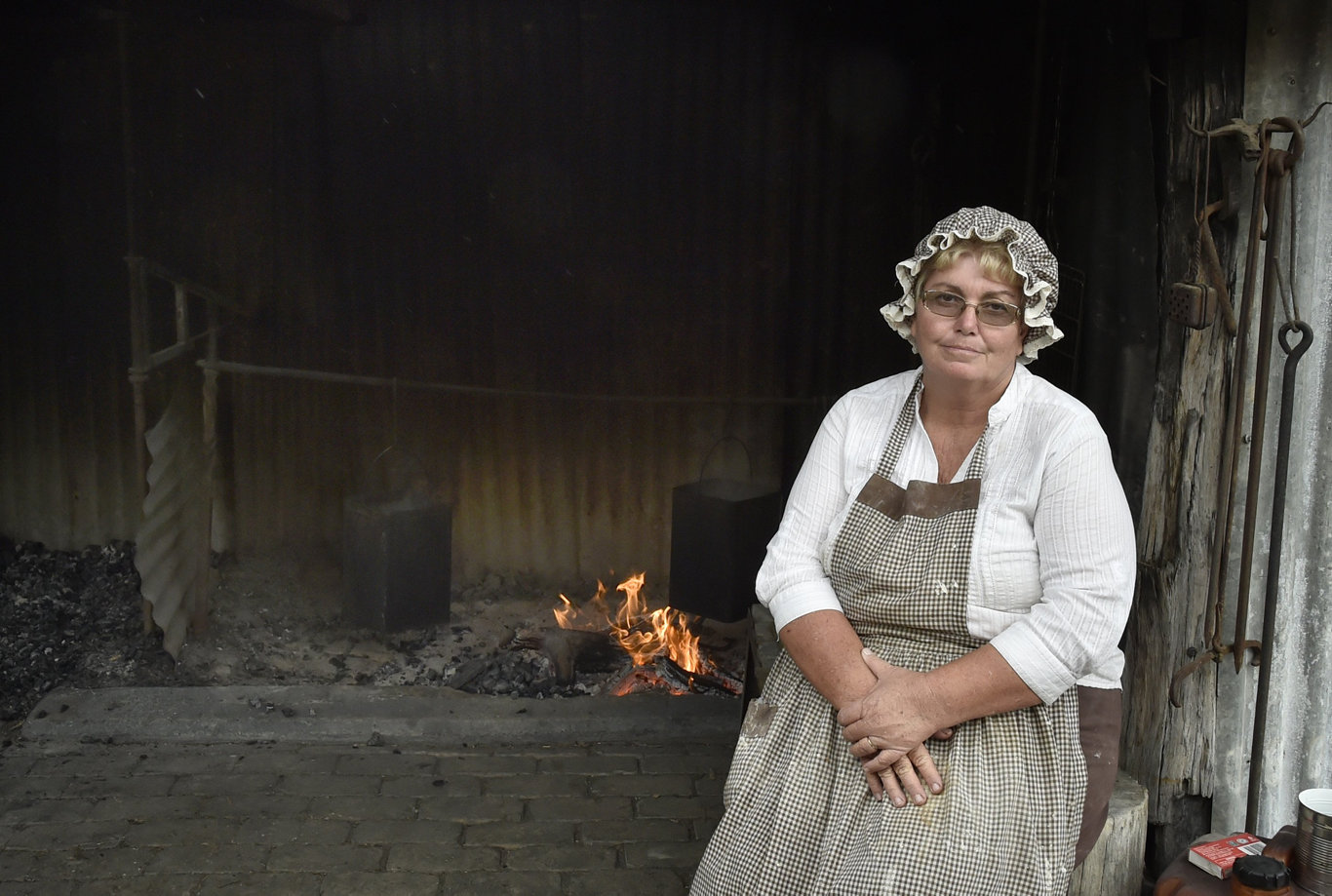 Making damper in the camp ovens is Jondaryan born and bred Mary-Lou Wicks. Jondaryn Woolshed, Winter Hertiage Festival. July 2019