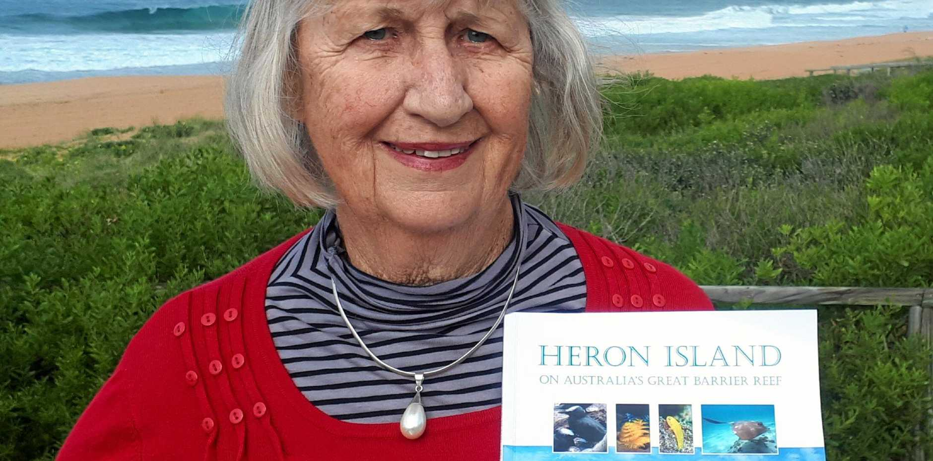 NEW BOOK: Author Jill Bruce with the cover of her new book,  Heron Island on Australia's Great Barrier Reef .