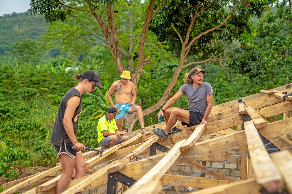 TOP JOB: Hervey Bay's Troy Sullivan (right) during the building of the school.