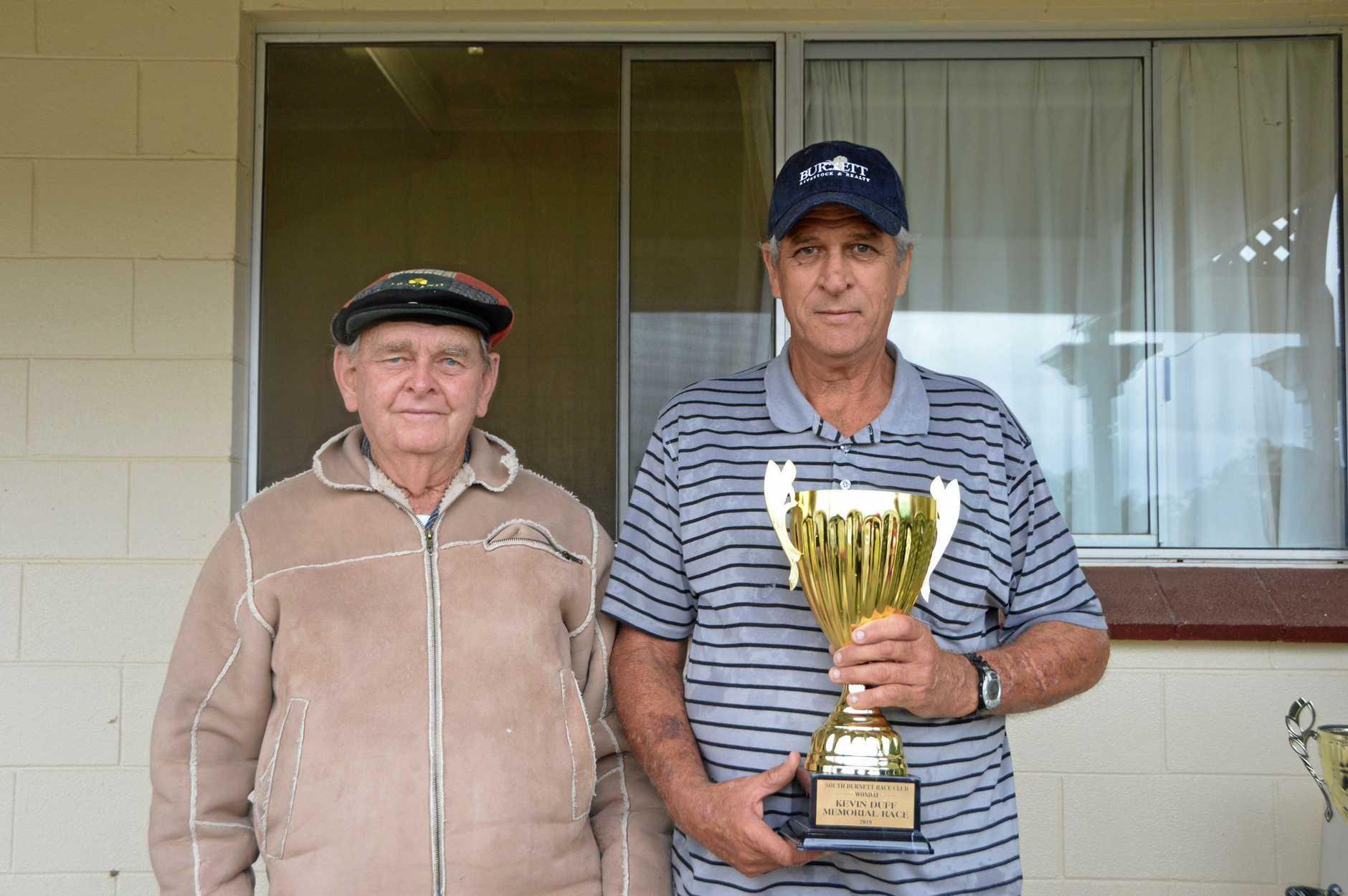 Cedrick Duff presented the Kevin Duff memorial trophy to winning trainer Darryl Gardiner.