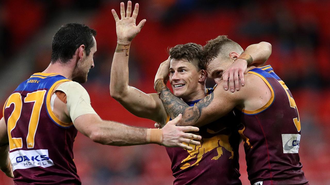 Brisbane stalwarts Dayne Zorko, Darcy Gardiner and Mitch Robinson celebrate the win. Picture: Phil Hillyard