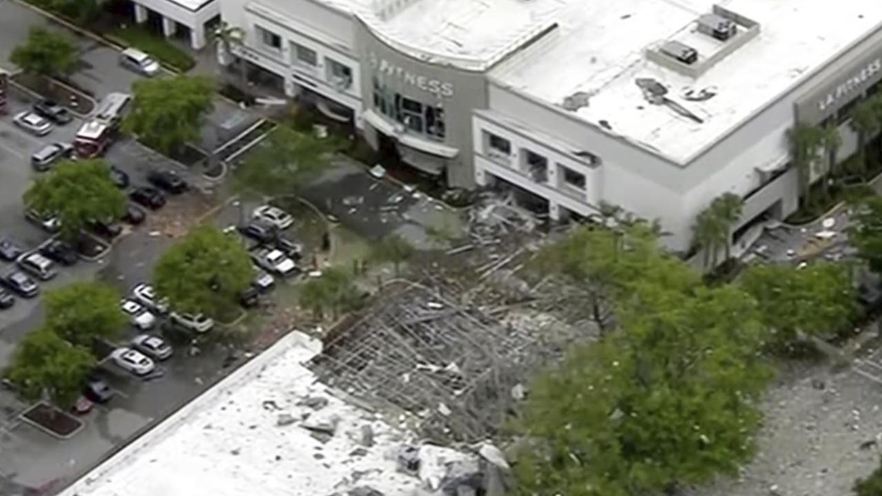 Debris covers the parking lot of a shopping centre after an explosion on Saturday, July 6, 2019 in Plantation, Florida. Picture: WPLG via AP