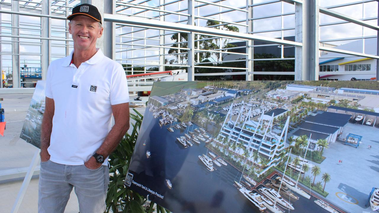 Tony Longhurst in front of the planned designs.
