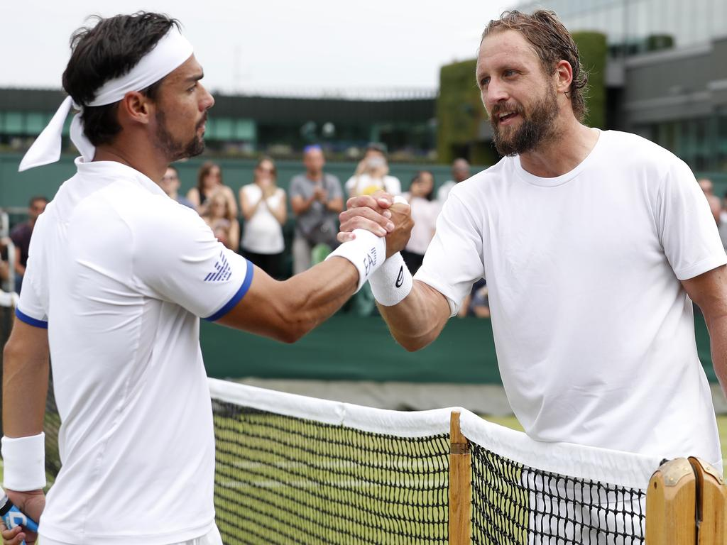 United States' Tennys Sandgren, right, greets Italy's Fabio Fognini at the net after winning their Men's singles match. Picture: AP