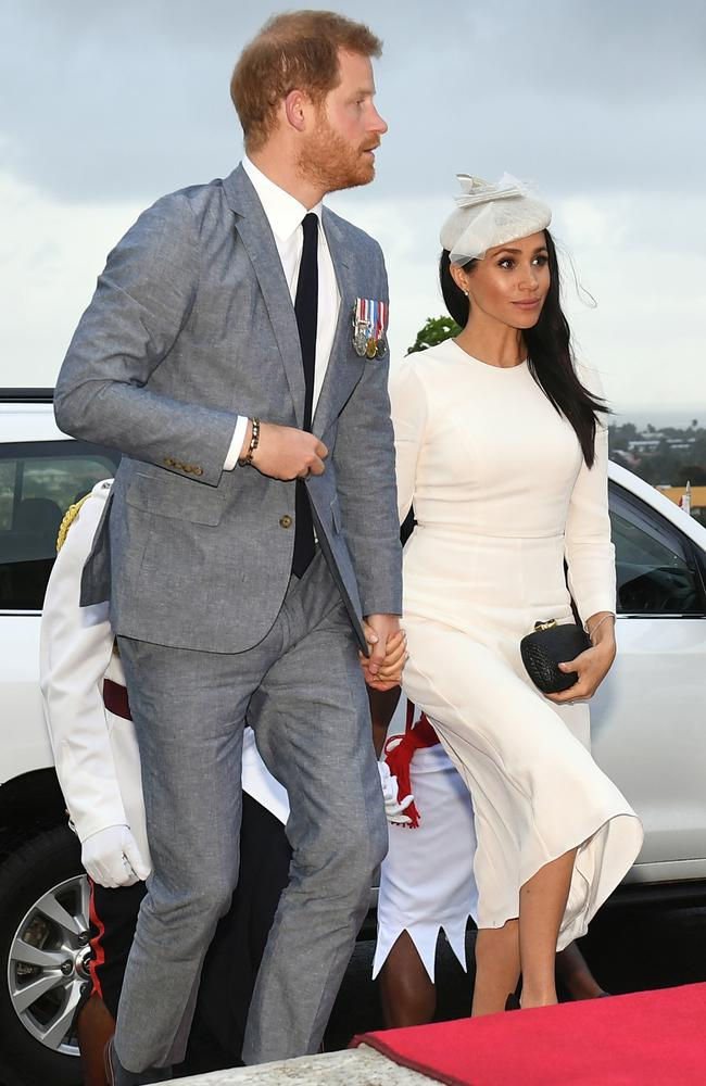 Prince Harry pictured with Meghan, the Duchess of Sussex, in Fiji, where she wore Australian designer, Zimmermann. Picture: Getty Images