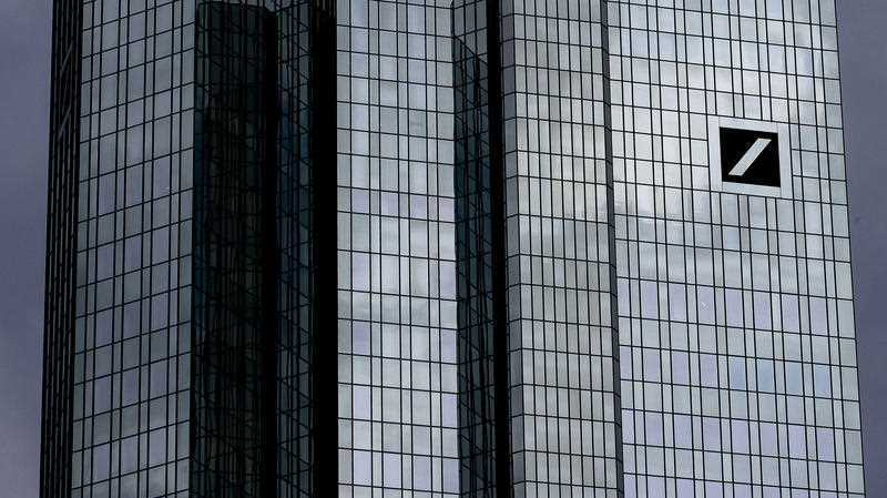 Dark clouds reflect in the facade of the headquarters of Deutsche Bank in Frankfurt, Germany, Sunday, July 7, 2019. The supervisory board of the bank meets on Sunday to decide about further strategies.