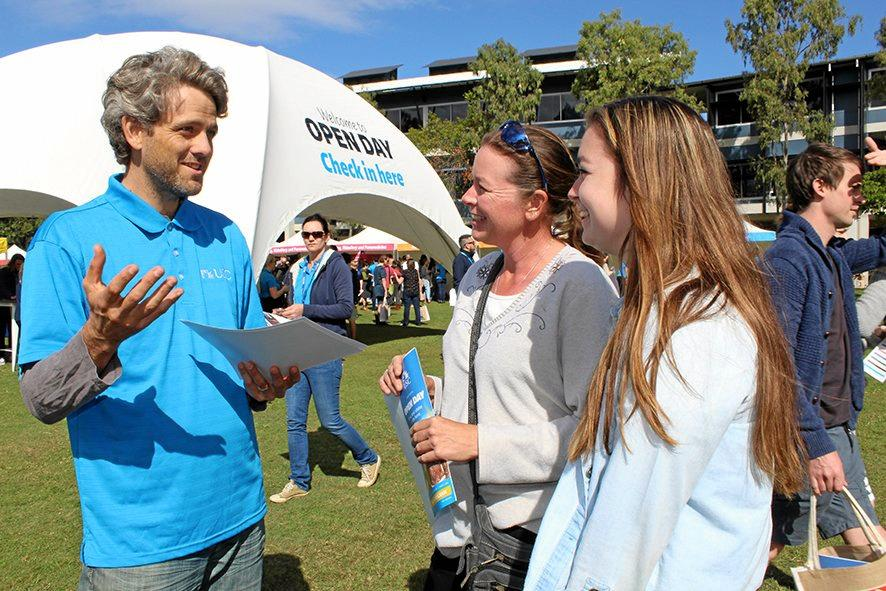 OPEN DAY: USC   Journalism lecturer Dr Peter English   with Kenilworth's Jodie and Mika Francis.