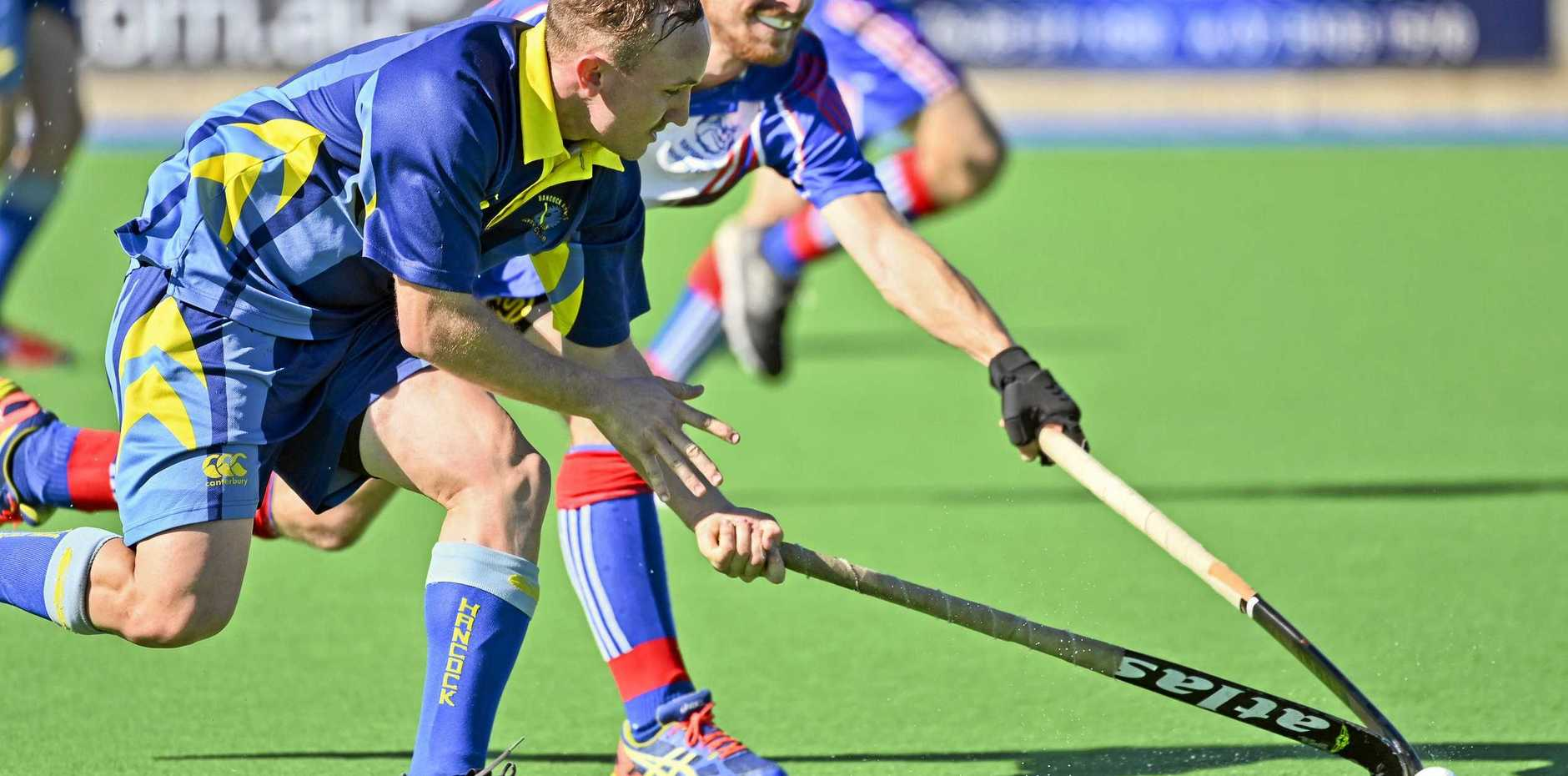 FINALS' WARM-UP: Hancocks A-Grader Ryan Smith takes on his Toowoomba Rangeville opponent during a recent match. The Combined Competition finals are on at the Ipswich Hockey Complex on Sunday.