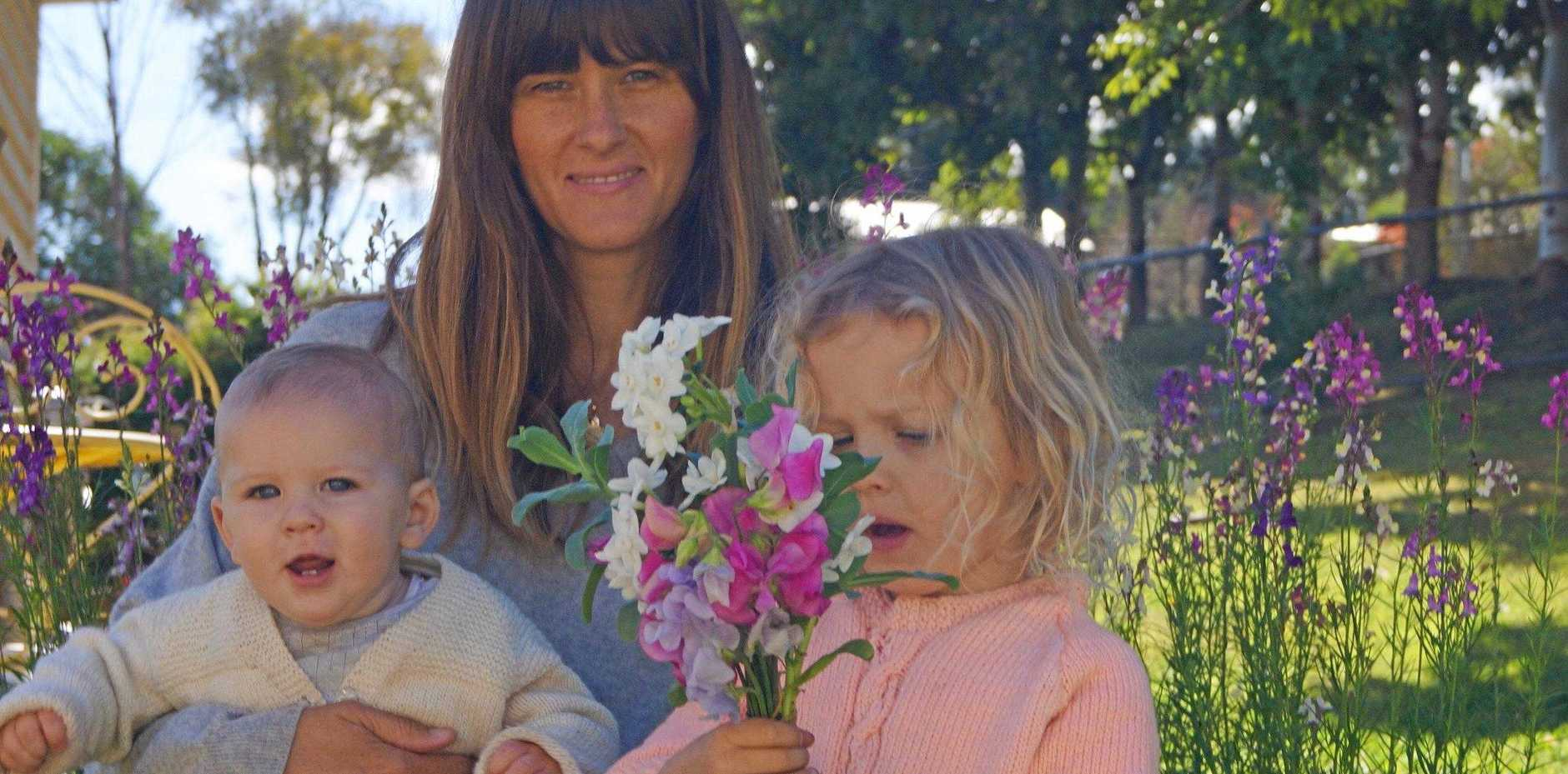 FLORAL FUN: Stacey Gillies is thrilled she is able to share her love of the garden with her young children, Jasper and April.
