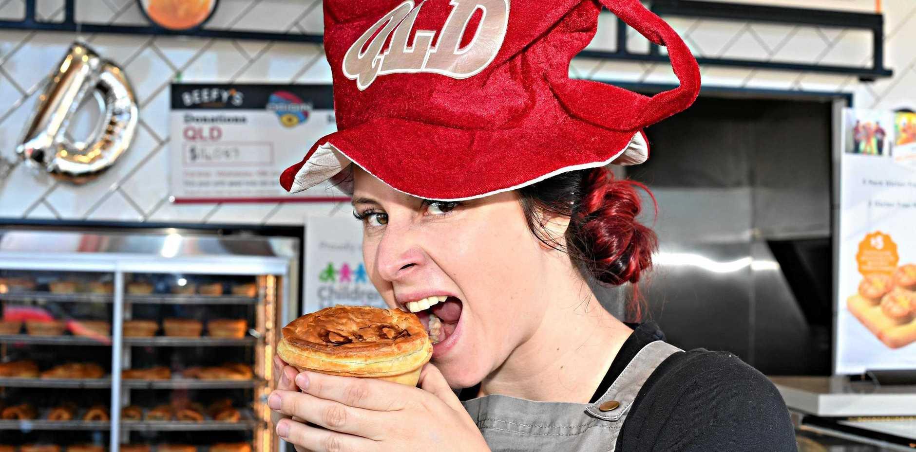 BIG QUEENSLANDER: Jasmin Gooding tucks into a best-selling Beefy's pie ahead of