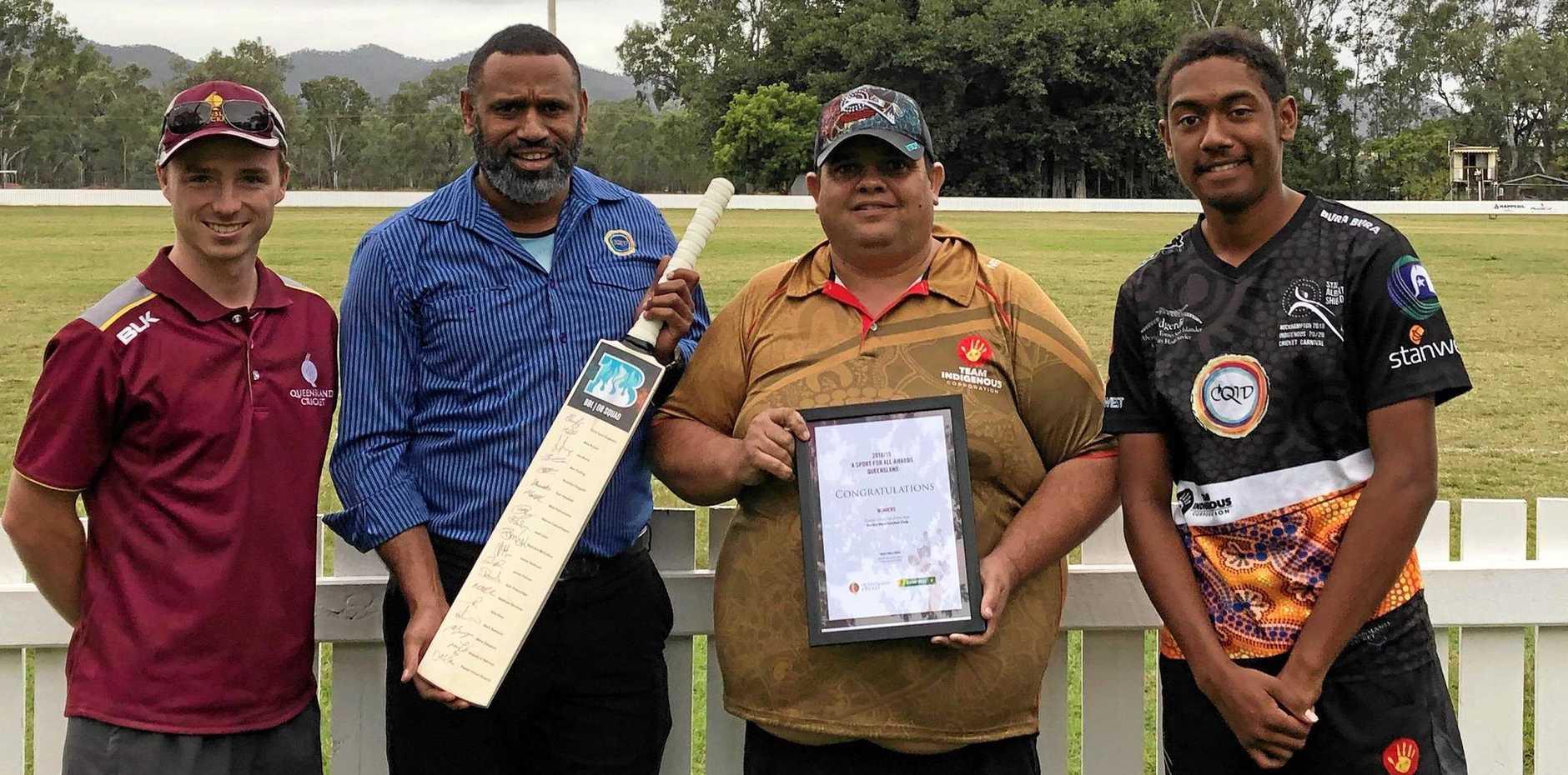 WELL DESERVED: Queensland Cricket's Kade Horan (left) congratulates Rocky Heat player Daniel Yasso, president Robbie Garrett and player Jackman Yasso on the club's award.