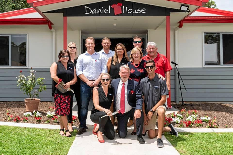 The Murphy Builders team with Bruce and Denise Morcombe at Daniel House.