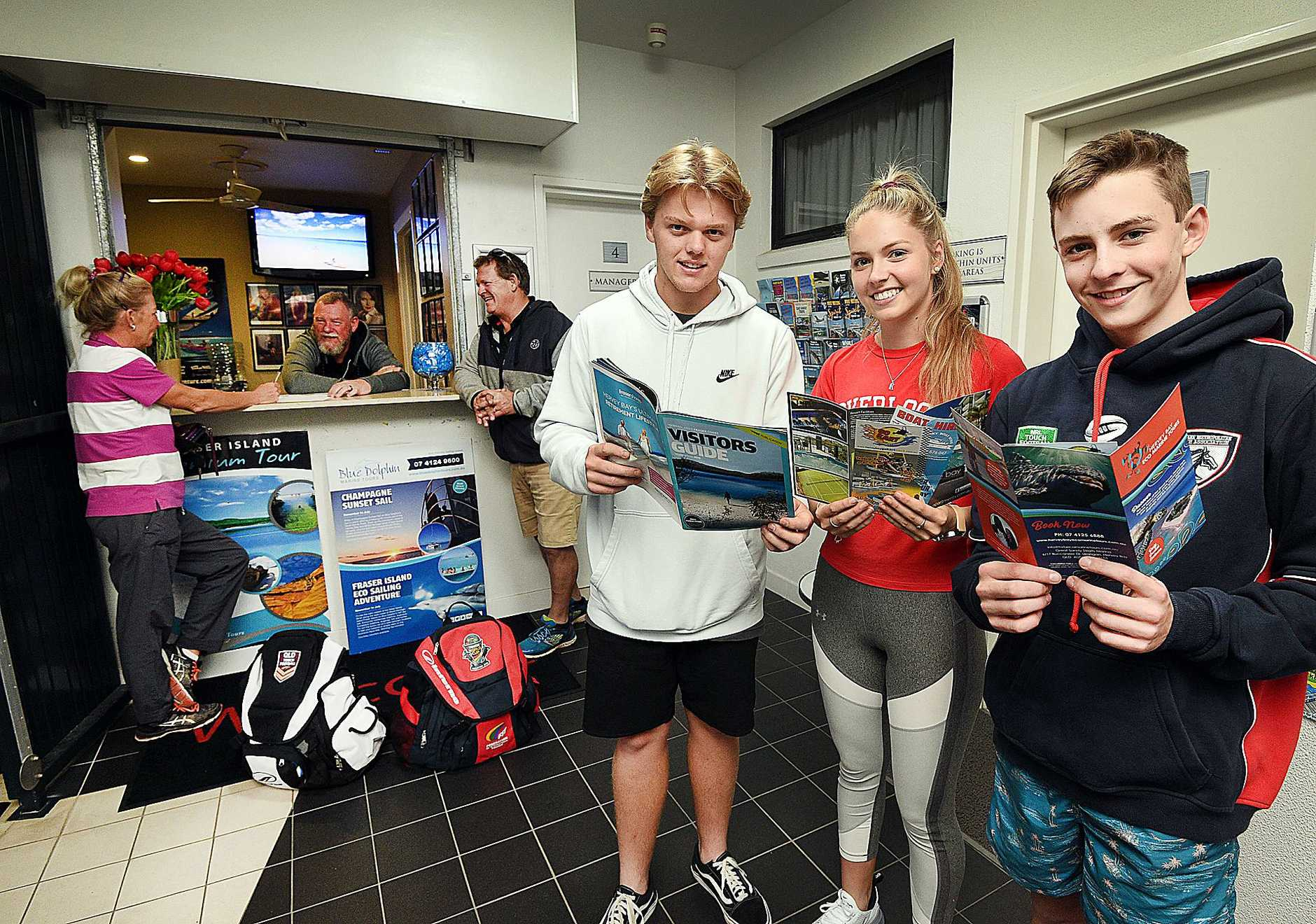 FOOTY FAMILIES FLOOD IN: Lorelle and Jim Sankey from Dalby check in with Bay Apartments owner Derek Foulston as players (from left) Max Brady and Karla and Brock Sankey take a look at the local tourist attractions.