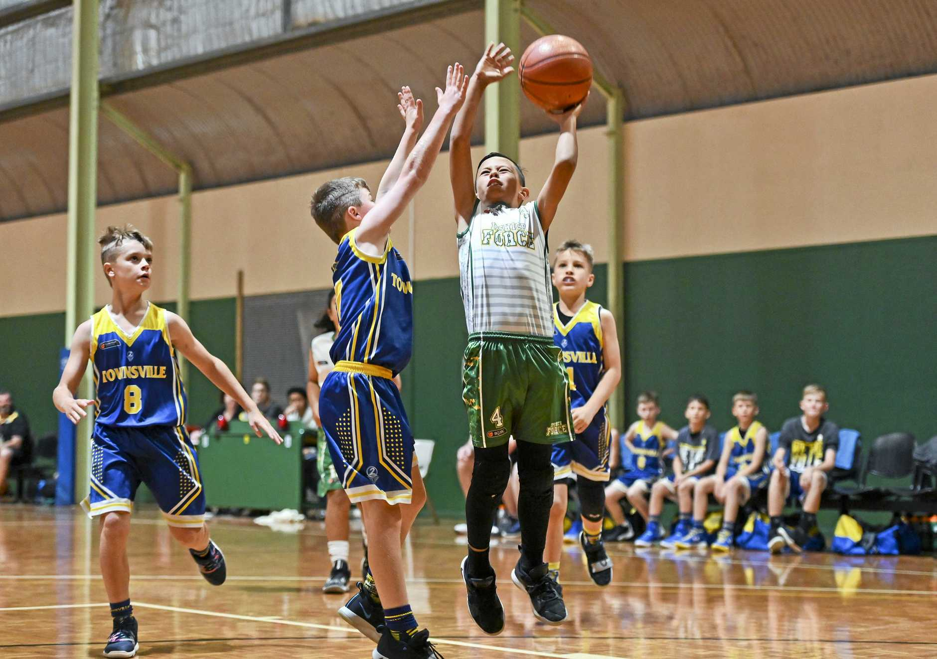 Ipswich under-12 basketballer Kobi Patrick flies high for his team on their way to gold medal glory at the state titles.