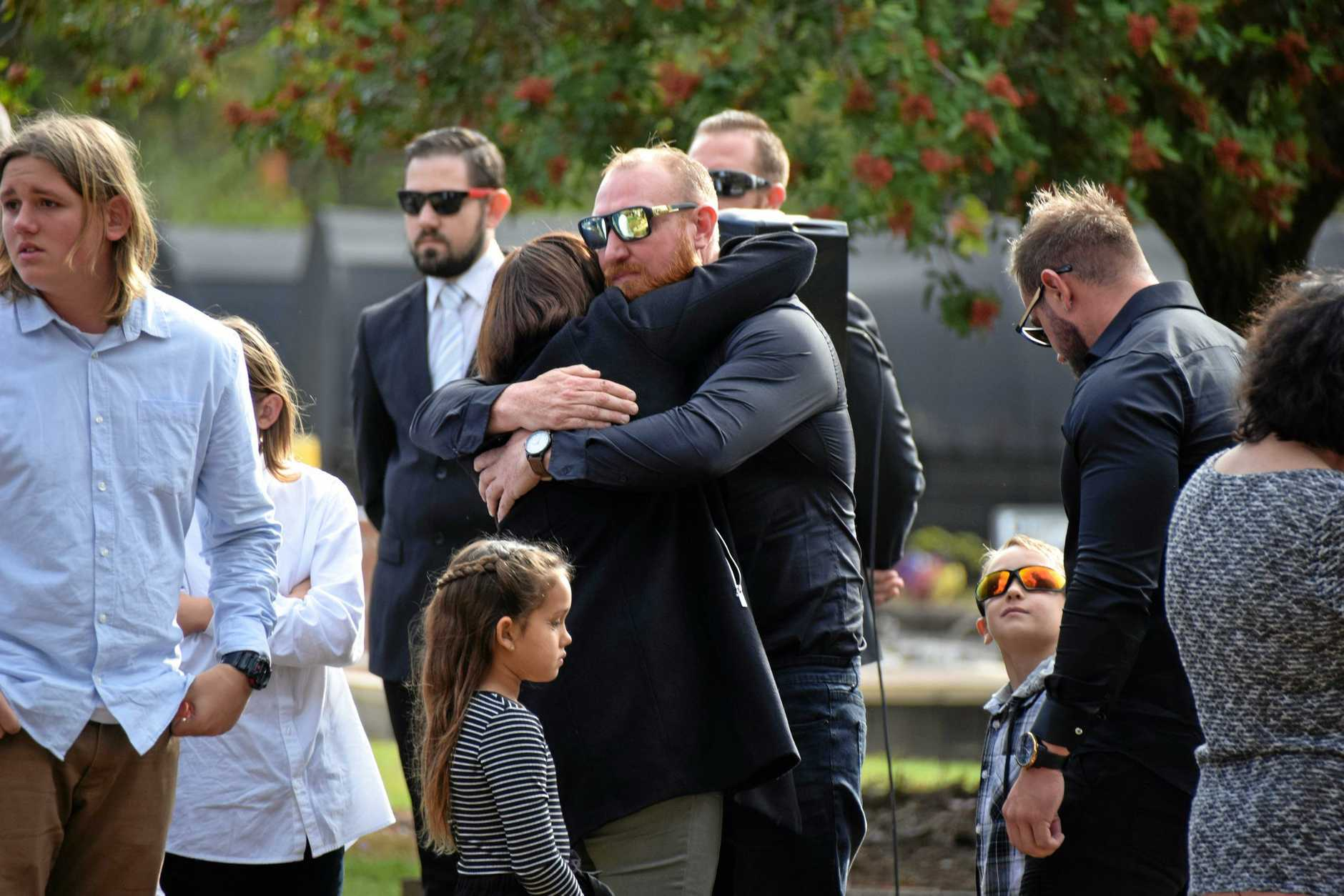 Daniel Routledge is showered in love and from family and friends at the funeral for his father, David.