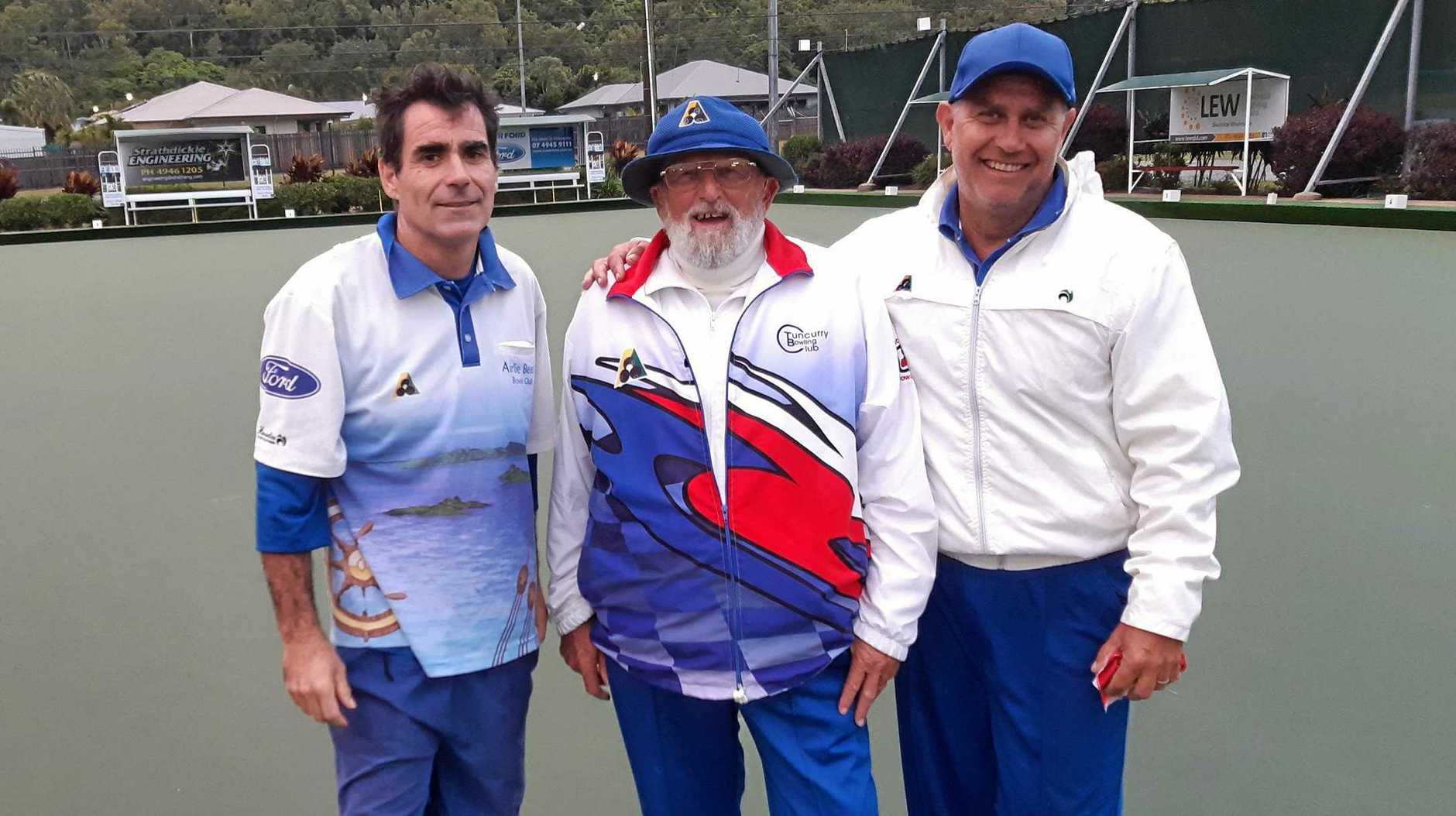 Andy Bell, John Beach Snr and Man Isgro following a semi-final clash played in the drizzling rain at Airlie Beach Bowls Club.