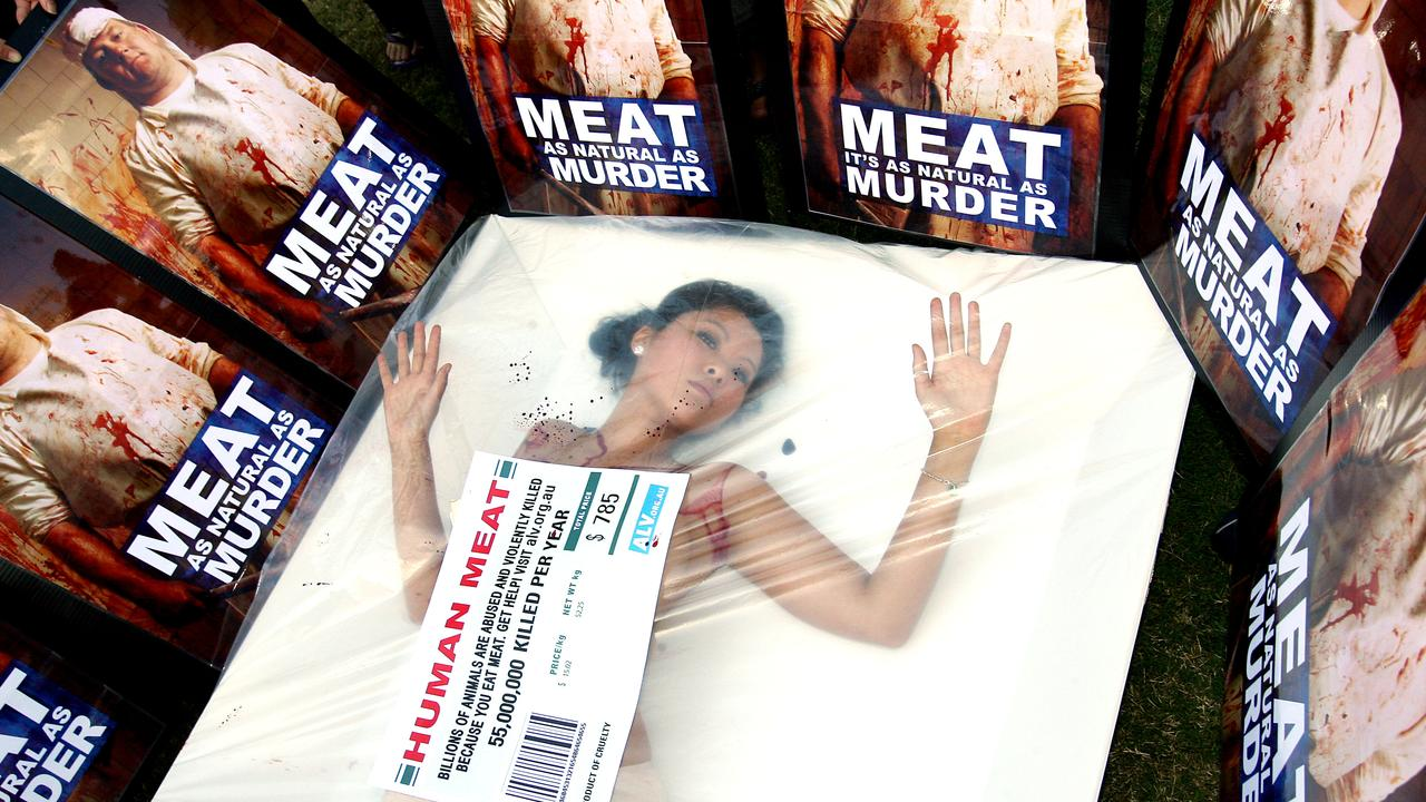 An animal liberation protester in Brisbane threw fake blood over herself and climbed into an oversized meat tray. Picture: PeterWallis